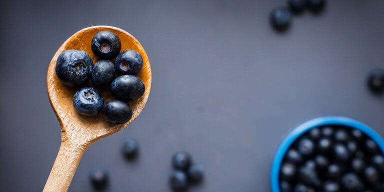 Wooden spoonful of blueberries
