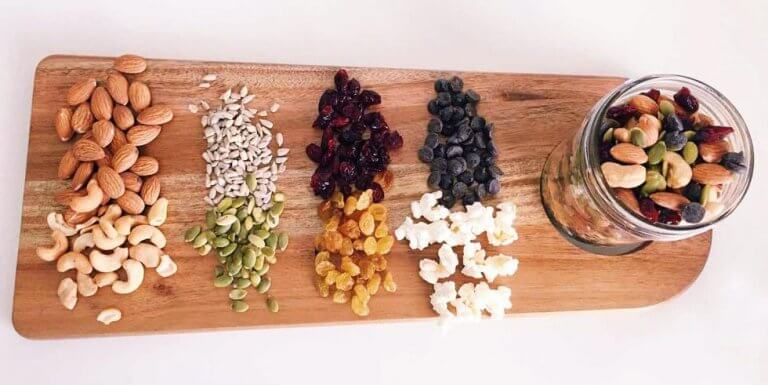 Trail mix ingredients on a wooden cutting board