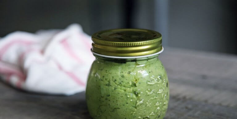 Glass jar of pesto
