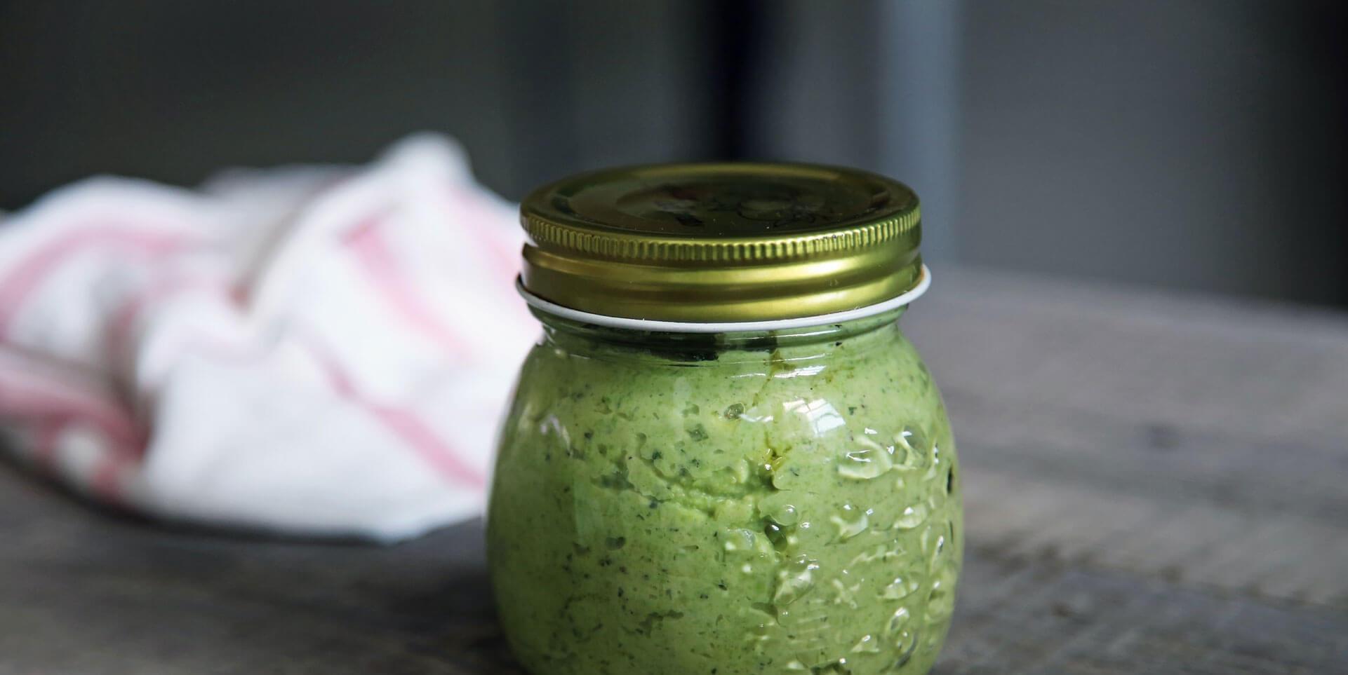 Glass jar of pesto