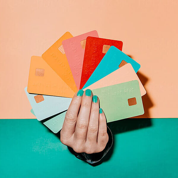 Hand holding colourful debit cards