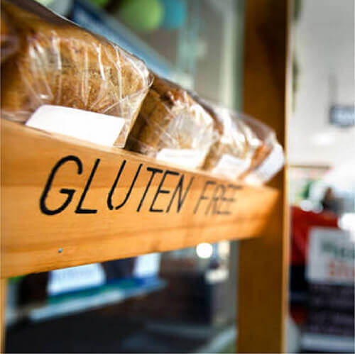 Wooden gluten free sign with loaves of bread