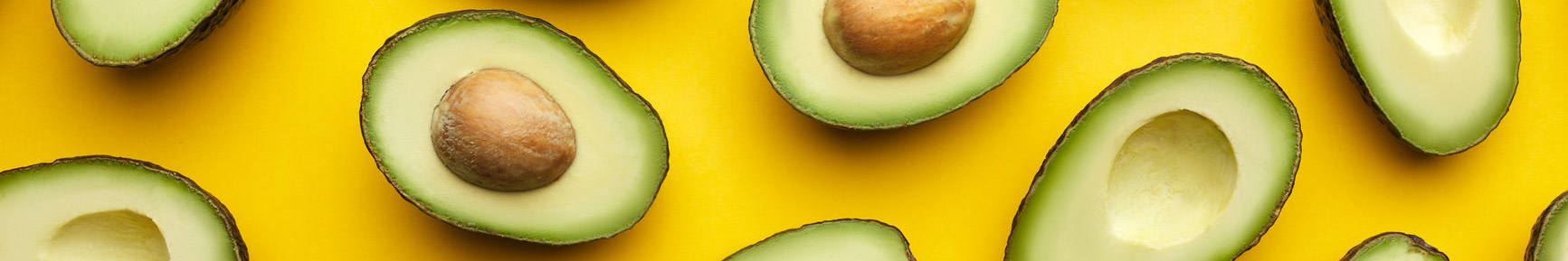 Avocados against a yellow background