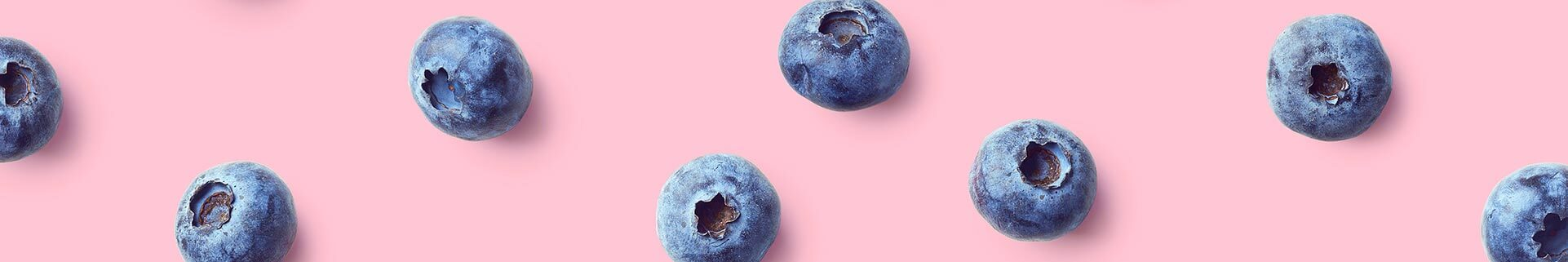 Blueberries on pink background