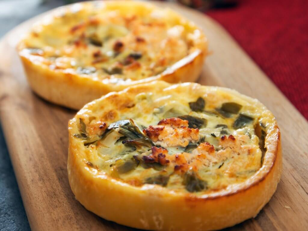 Two quiches on wooden board