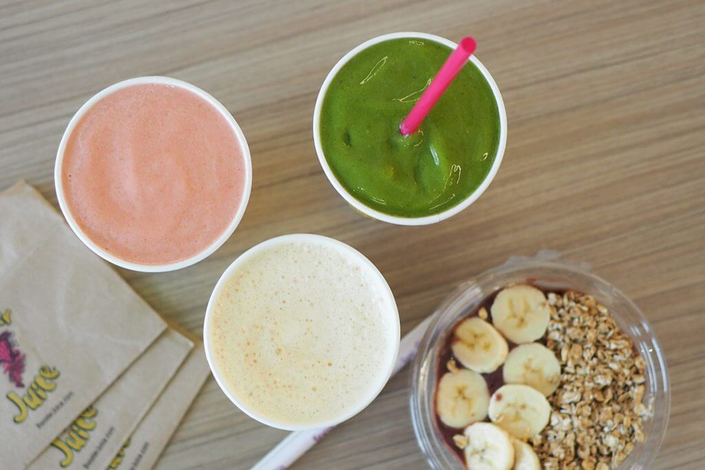 Three smoothies and an açaí bowl
