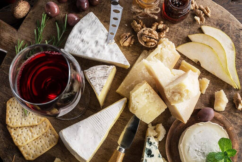 Various cheeses with wine and crackers