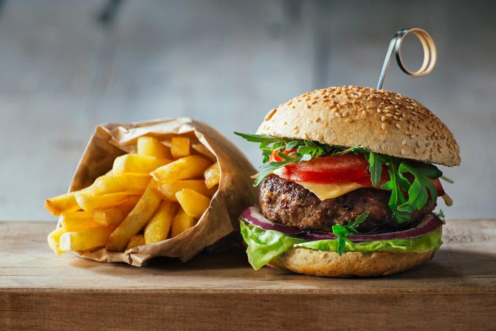 Burger and fries on a wooden table