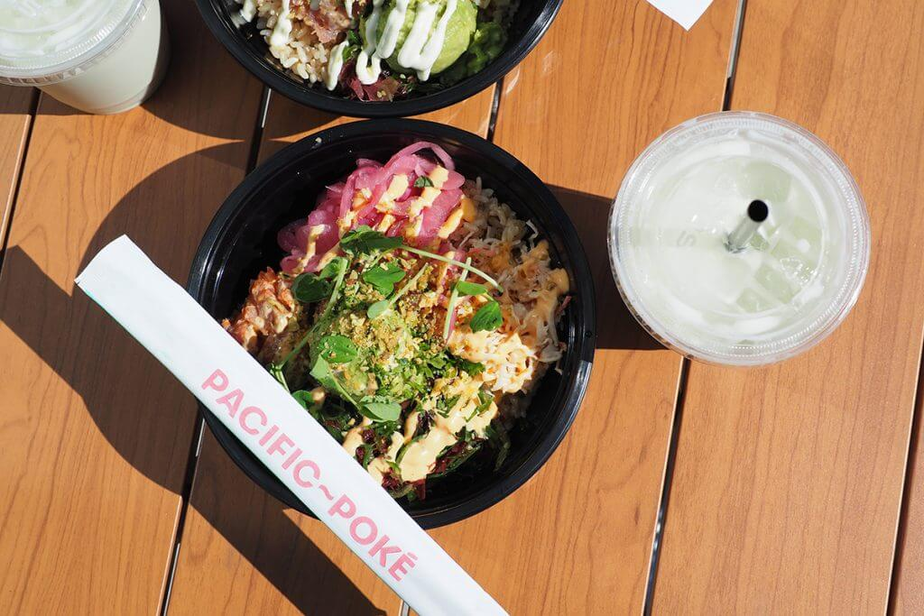 Poke bowl served with drink