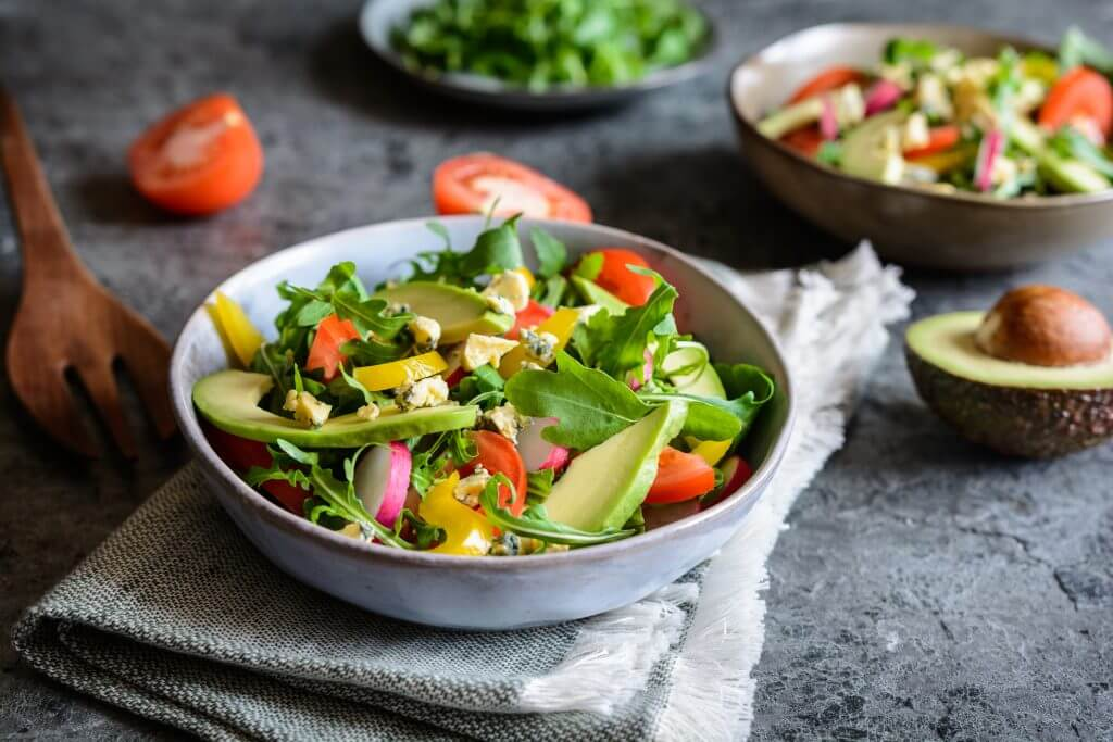 Arugula salad served with avocado