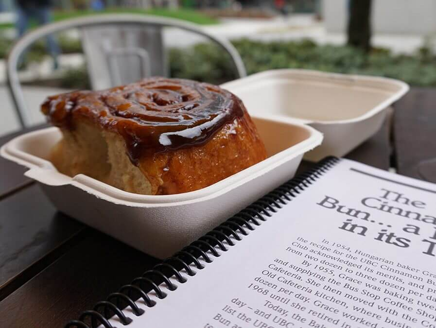 UBC Cinnamon Bun in a to-go container