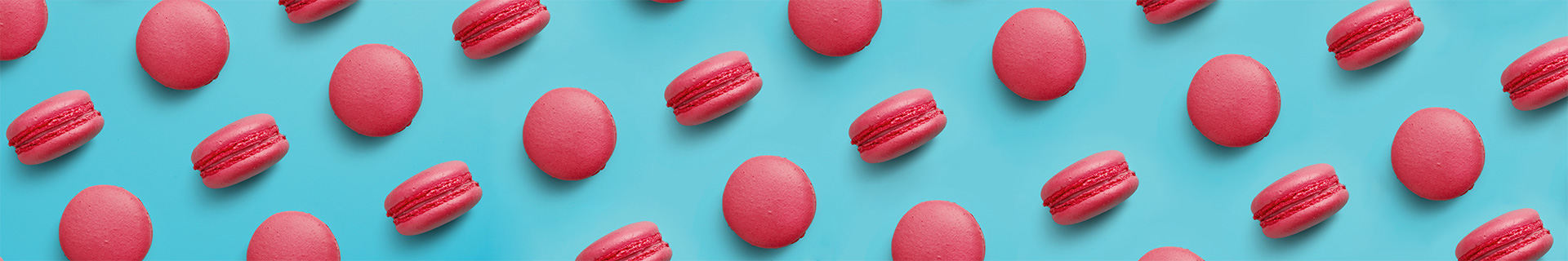Red macarons against a blue background