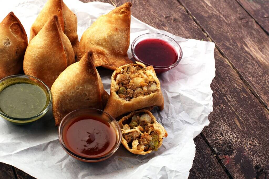 Samosas served with sauces