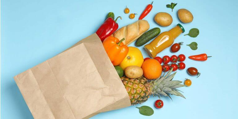 Spilling grocery bag with fruits, vegetables, and grains