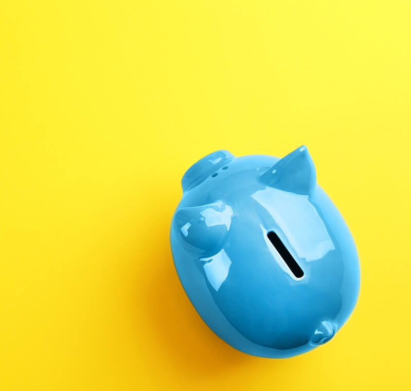 Blue piggy bank against a yellow background
