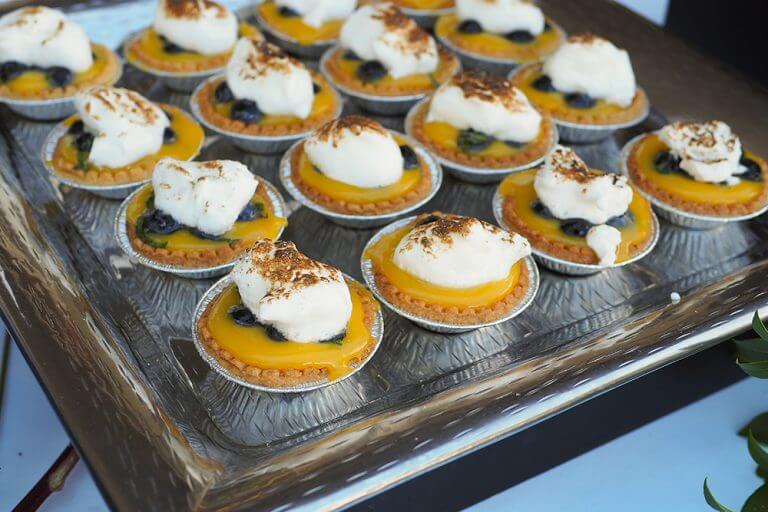 Rows of blueberry lemon tarts