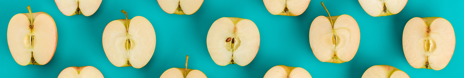 Apples against a blue-green background