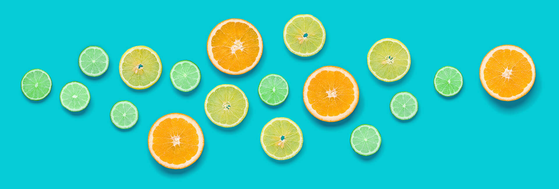 Citrus fruits against a blue-green background