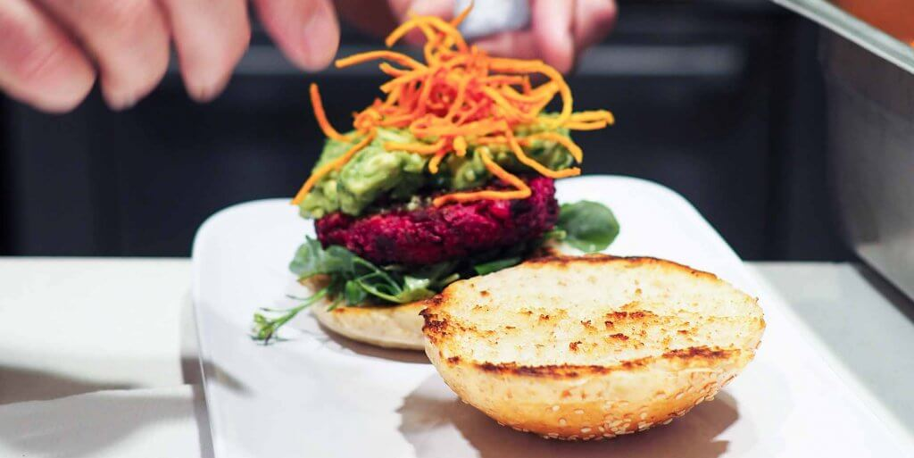 Open faced beet Burger on a white plate