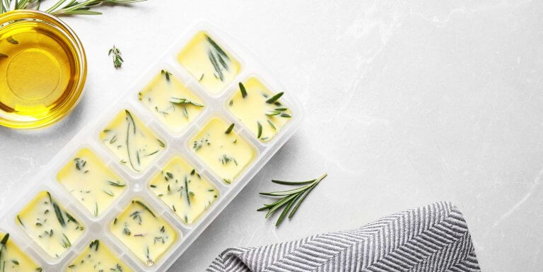 Frozen herbs in ice cube tray