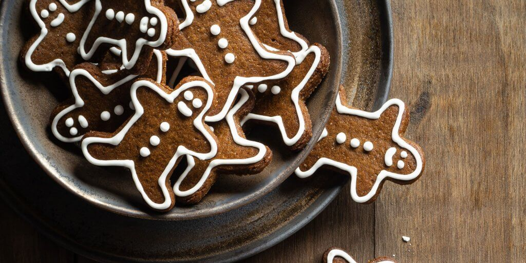 plate of gingerbread cookies on wooden table